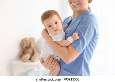 Female doctor with baby at hospital