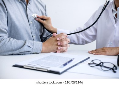 Female doctor checking heart beat of patient and recommend treatment methods and how to use medicine.