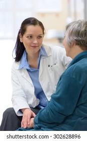 Female doctor comforting senior patient