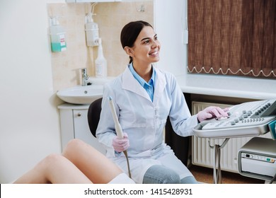 Female doctor conducting ultrasound examination of woman in clinic