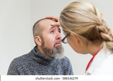 female doctor is doing a examination of an eye with stye