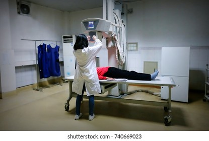 A female doctor is doing X-ray examination to the patient