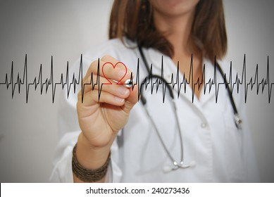 Female doctor drawing a heartbeat. Medical concept.