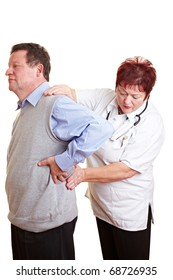 Female doctor examing kidney problems of a male patient