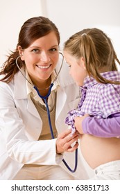 Female doctor examining child with stetoscope at medical office