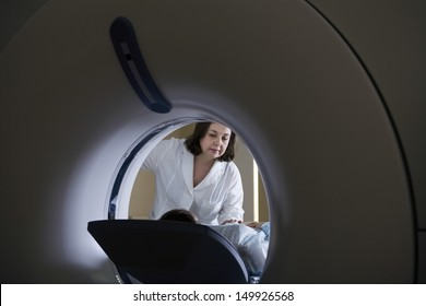 Female doctor examining patient before CT scan