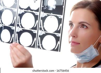 Female doctor examining a x ray