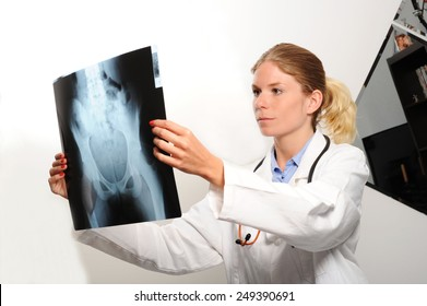 Female doctor examining an x-ray image