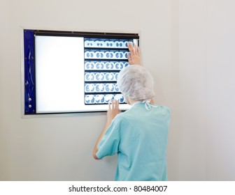 Female doctor examining an X-Ray image of patient