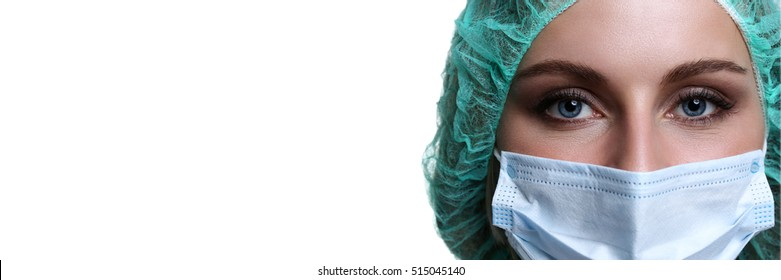 Female doctor face wearing protective mask and green surgeon cap closeup isolated on white background. Save patient life, copy space banner, laboratory, 911, medic help concept. Letterbox view