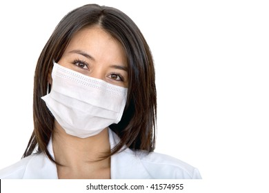 Female doctor with facemask isolated over a white background
