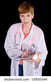 Female doctor filling out paperwork on a clipboard. Shot on a black background.
