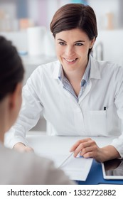 Female doctor giving a consultation to a patient and explaining medical informations and diagnosis