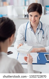 Female doctor giving a prescription medicine to the patient, healthcare and treatment concept