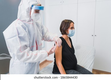 Female Doctor giving a vaccine to a pregnant woman against Covid 19 or flu or whooping cough. COVID-19 coronavirus vaccine. - Shutterstock ID 1865844430
