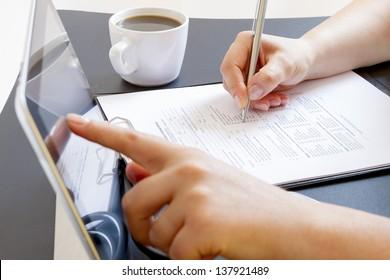 Female doctor hands using digital tablet at the desk