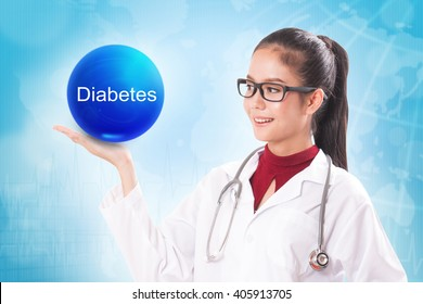 Female doctor holding blue crystal ball with diabetes sign on medical background.