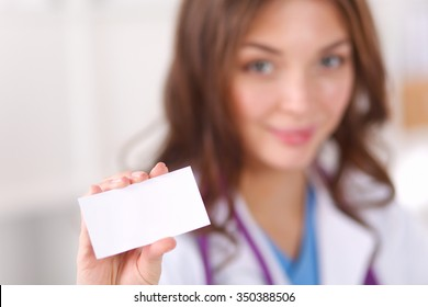 female doctor holding an empty card, isolated on white background