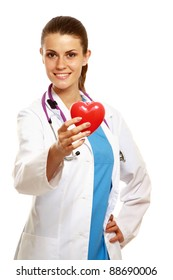 A female doctor holding a heart, isolated on white background