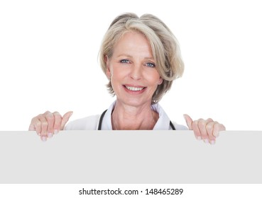 Female Doctor Holding Placard Over White Background