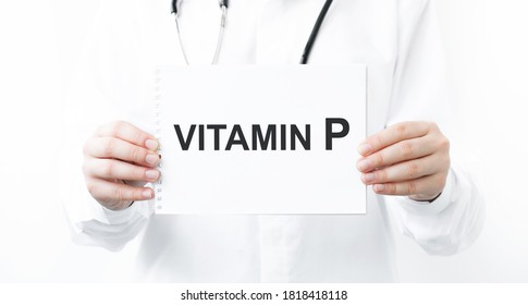 Female doctor holding a tablet with the text Vitamin P. Medical concept.
