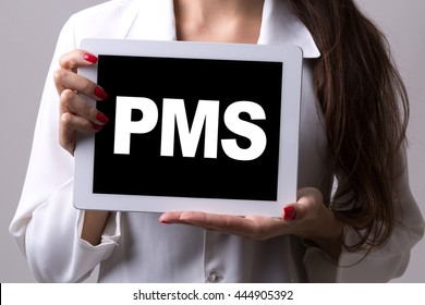 Female doctor holding a tablet with the text: PMS
