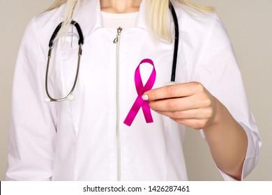 Female Doctor Holds Pink Ribbon, International Breast Cancer Day October 7 - Image