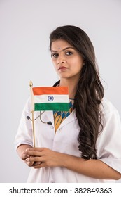 Female doctor with indian flag or tri colour, showing patriotism, isolated on white