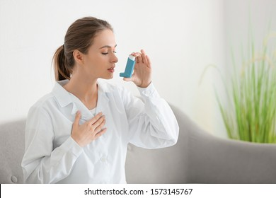 Female doctor with inhaler having asthma attack in clinic