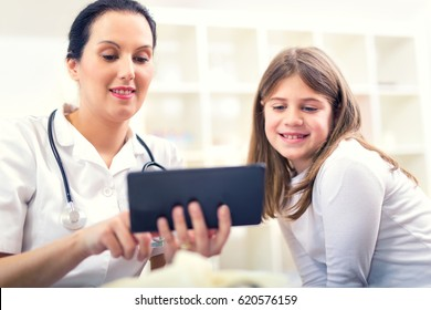 Female doctor and little girl patient. Medical examination.