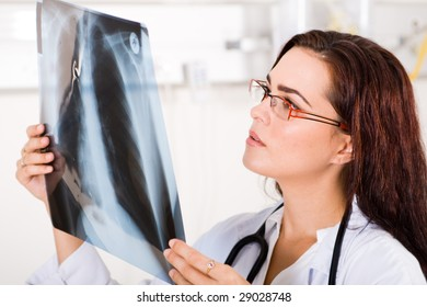 female doctor looking at a lungs or torso xray