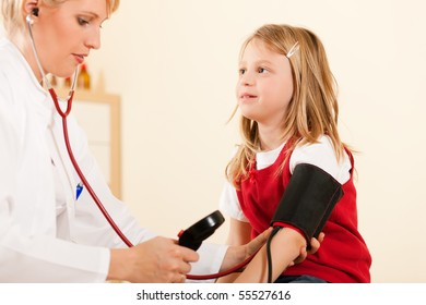 Female doctor measuring blood pressure of a child patient using the pressure sleeve and her stethoscope