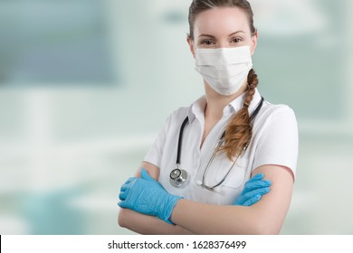 Female doctor or nurse with medical face mask and medical gloves for protection