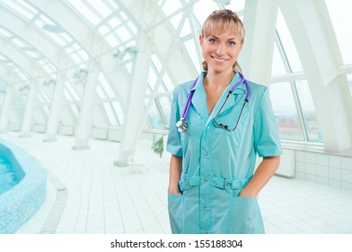 a female doctor on a background of white window