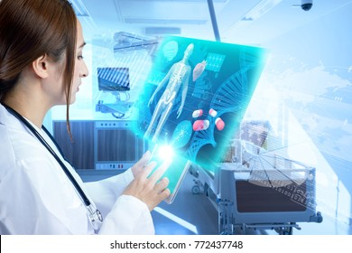 Female doctor operating futuristic medical interface.