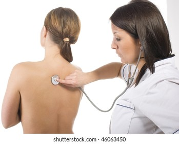 Female doctor performing breast examination
