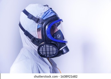 female doctor in protective suit and gas mask