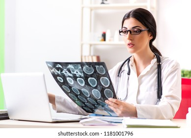 Female doctor radiologist with x-ray can image