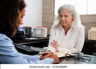 Female doctor reassuring a patient in consultation