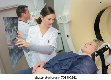 female doctor showing mri patient results