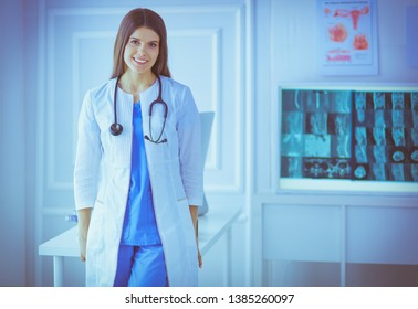 Female doctor standing at hospita with her stethoscope hanging on her neck