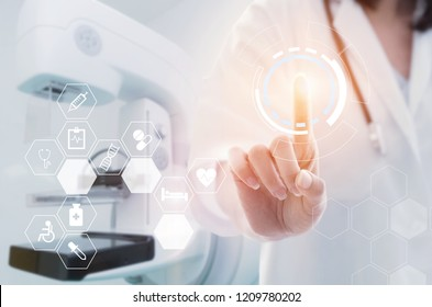female doctor with stethoscope hand pointing touching data digital icon hologram with operating room with Mammography X-Ray System Machine in hospital background, innovation, medical, future concept