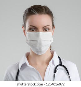 female doctor with stethoscope and medical face mask