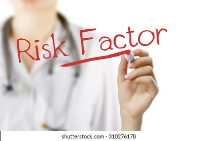 """Female doctor with stethoscope writing """"Risk Factor"""" . Hand holding pen isolated on white. Medical background."""