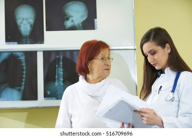 Female doctor talking to patient in hospital
