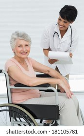 Female doctor talking to a senior patient in wheelchair at the hospital