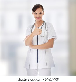 Female doctor with thumbs up