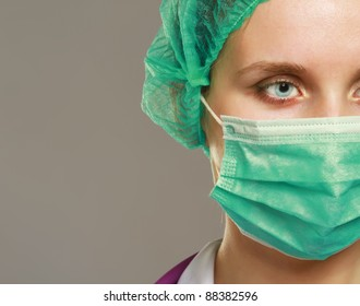 A female doctor wearing a mask, isolated on white
