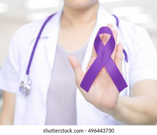 Female doctor in white uniform with purple awareness of ribbon in hand for ADD,ADHD,Alzheimer's Disease ,Arnold Chiari Malformation,Childhood Hemiplegia & stroke, Epilepsy, Chronic & Acute Pain,Crohns