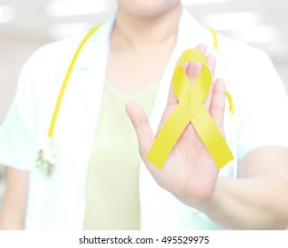 Female doctor in white uniform with Yellow ribbon awareness in hand for Bladder Cancer,Bone cancer / Osteosarcoma, Endometriosis,Ewings Sarcoma,Hydrocephalus, Liver Cancer Liver Disease Microcephaly